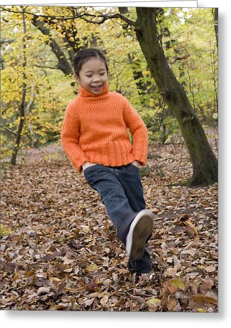 Girl Kicking Leaves Greeting Card by Ian Boddy