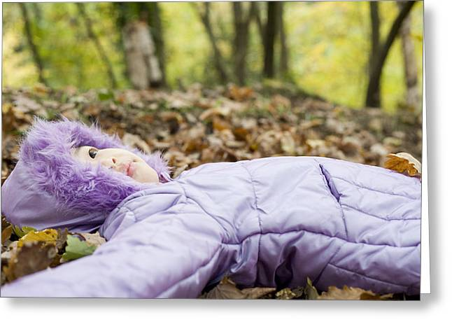 Girl Lying On Autumn Leaves Greeting Card by Ian Boddy