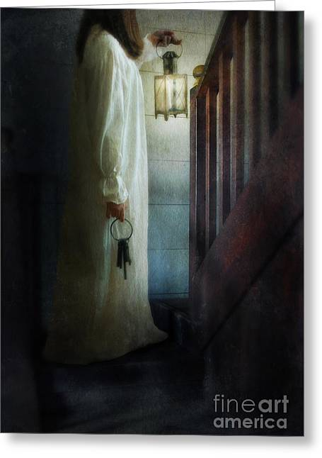 Girl On Stairs With Lantern And Keys Greeting Card by Jill Battaglia
