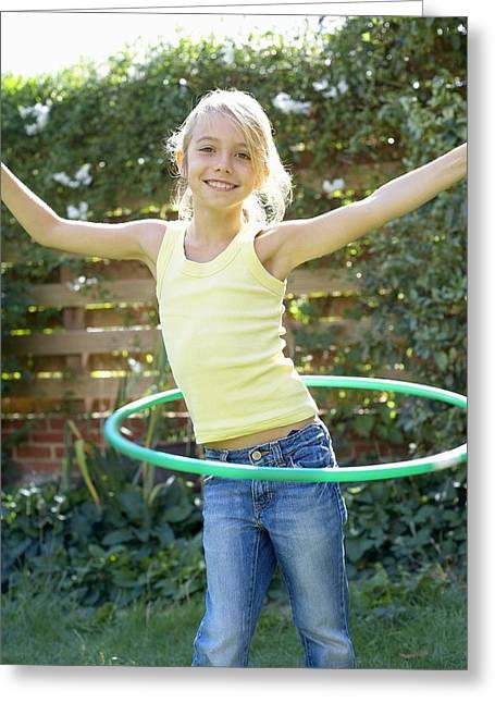 Girl Playing With A Hula Hoop Greeting Card