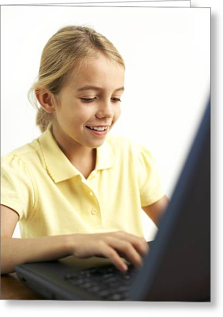 Girl Using A Laptop Computer Greeting Card by Ian Boddy