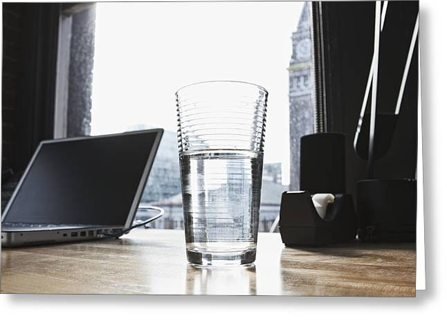 Glass Of Water And Laptop On A Desk Greeting Card by Jetta Productions, Inc