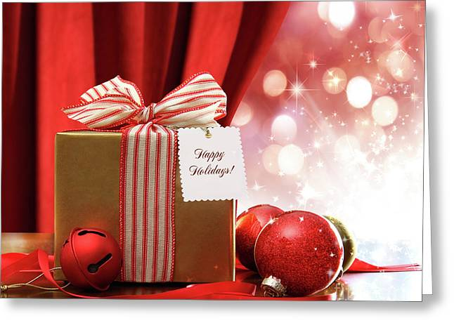 Gold Christmas Gift Box And Ornaments With Sparkle Lights  Greeting Card by Sandra Cunningham