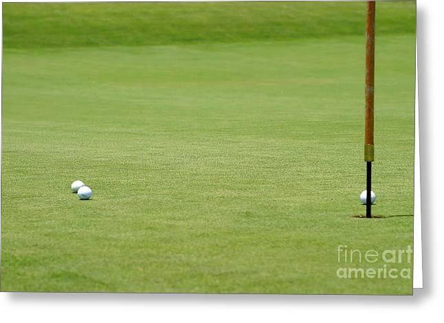 Golf Balls Near Flagstick Greeting Card by Henrik Lehnerer