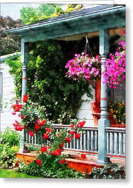 Hanging Baskets And Climbing Roses Greeting Card by Susan Savad