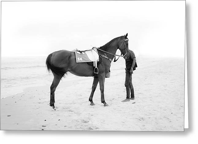 Horse And Man On The Beach Black And White Greeting Card by Kittipan Boonsopit