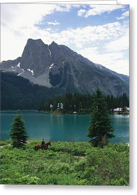Horseback Riding Around Emerald Lake Greeting Card by Michael Melford