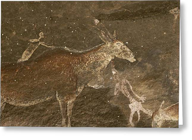 Hunters And Animals In A Cave Painting Greeting Card by Kenneth Garrett