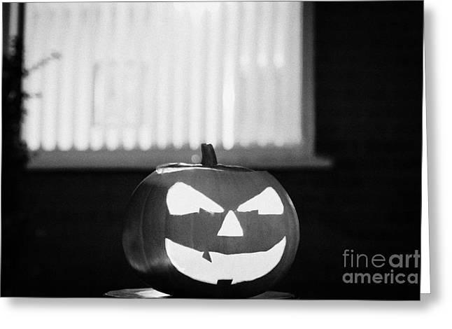 Illuminated Halloween Pumpkin Jack-o-lantern Outside The Window Of A House To Ward Off Evil Spirits  Greeting Card by Joe Fox