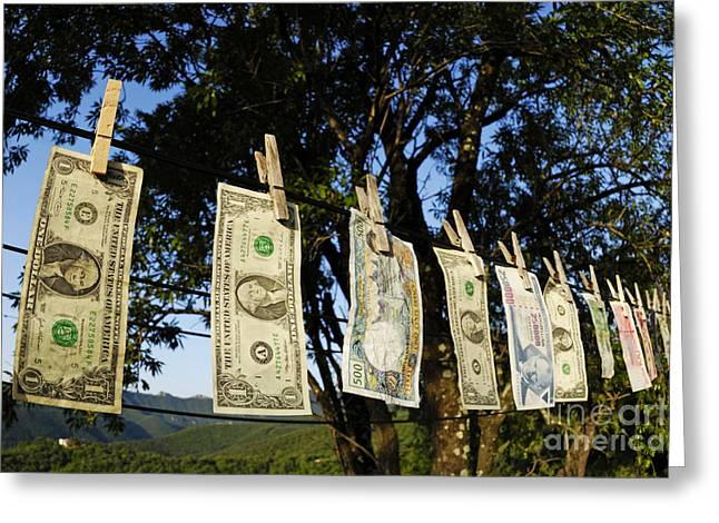 International Money Hanging On Clothesline Greeting Card by Sami Sarkis