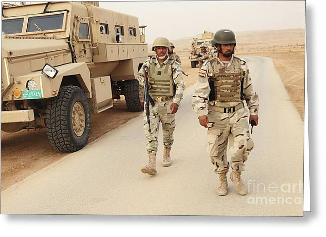 Iraqi Army Soldiers Walk Beside An Mrap Greeting Card by Stocktrek Images