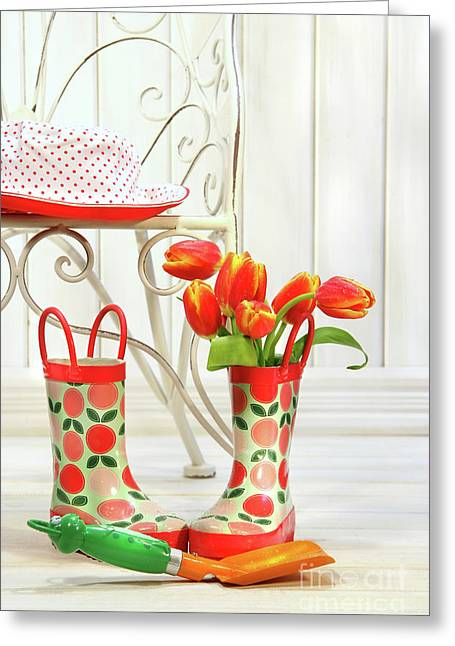 Iron Chair With Little Rain Boots And Tulips  Greeting Card by Sandra Cunningham