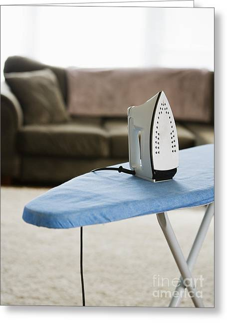 Iron On An Ironing Board Greeting Card by Ben Sandall