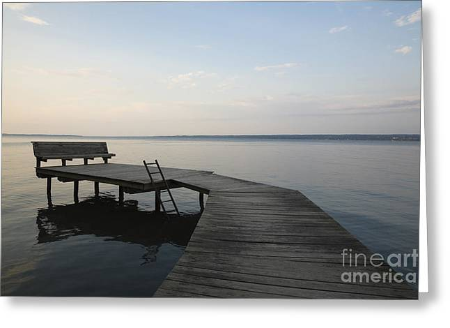 Lakeside Dock With Bench At Dusk Greeting Card