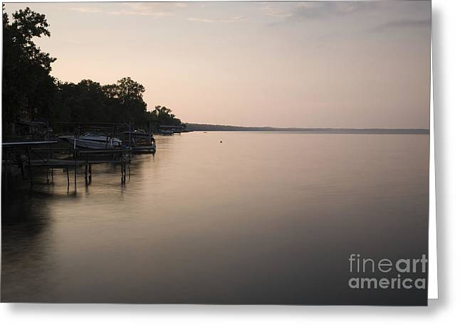 Lakeside Dock With Boat At Dusk Greeting Card