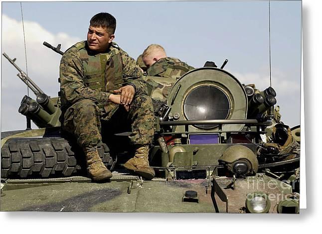 Light Armor Vehicle Crew Member Waits Greeting Card by Stocktrek Images