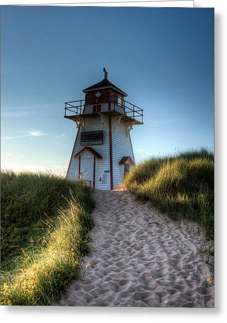 Lighthouse By The Sea Greeting Card by Matt Dobson