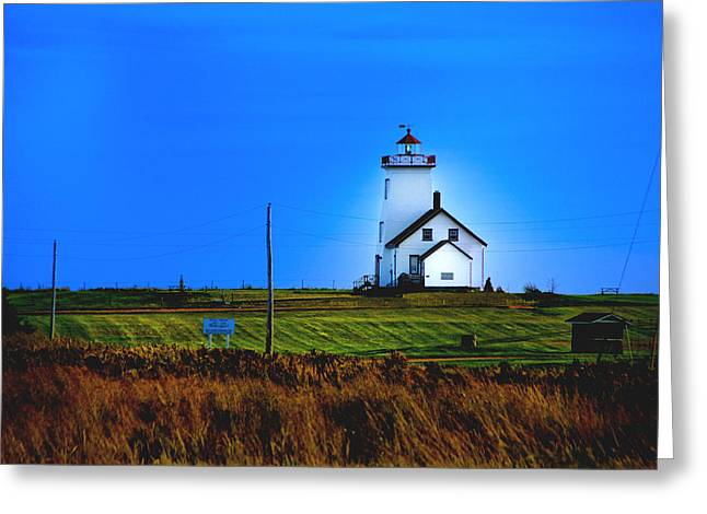 Lighthouse In Darkness Greeting Card by Rick Bragan