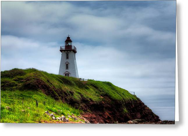 Lighthouse On A Cliff Greeting Card by Matt Dobson