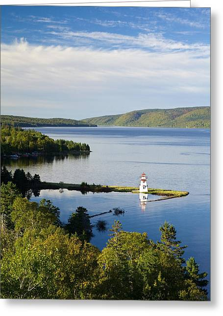 Lighthouse On Boulardarie Island Greeting Card by John Sylvester