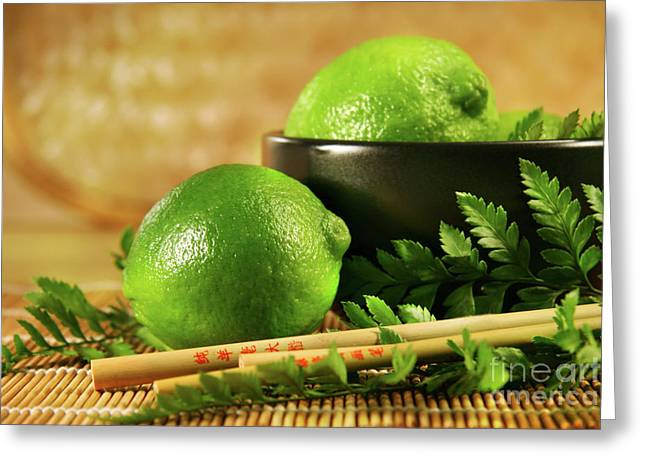 Limes With Chopsticks Greeting Card by Sandra Cunningham