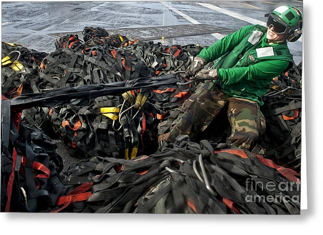 Logistics Specialist Wraps Cargo Nets Greeting Card by Stocktrek Images