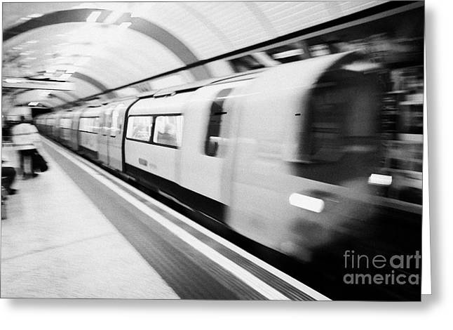 London Underground Train Arriving In Station England United Kingdom Uk Deliberate Motion Action Blur Greeting Card by Joe Fox