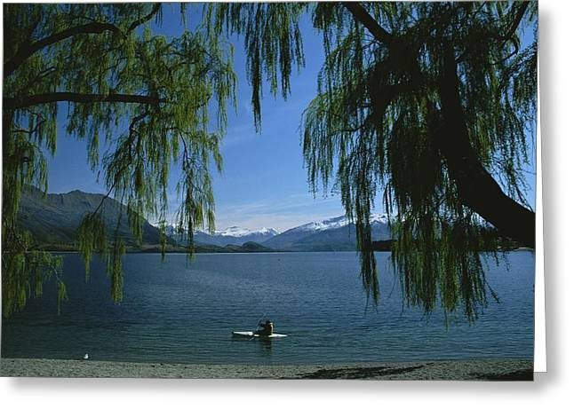 Lone Kayaker On A Lake With Snow-capped Greeting Card by Todd Gipstein