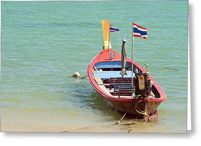 Longtail Boat At Sea Greeting Card by Bill Brennan