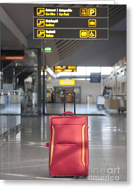 Luggage Sitting Alone In An Airport Terminal Greeting Card by Jaak Nilson