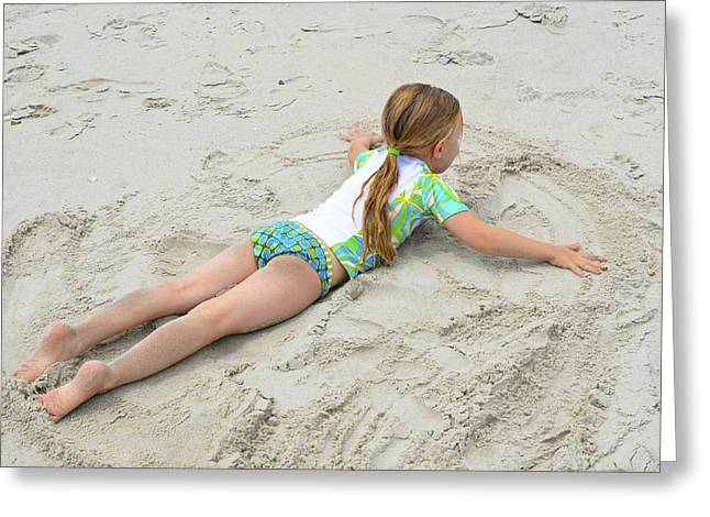 Greeting Card featuring the photograph Making A Sand Angel by Maureen E Ritter