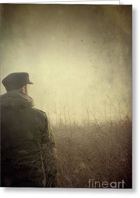 Man Alone In Autumn Field Greeting Card by Sandra Cunningham