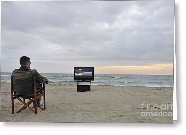 Man Watching Tv On Beach At Sunset Greeting Card by Sami Sarkis