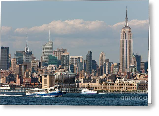 Manhattan Skyline And Ferry Traffic Greeting Card by Clarence Holmes