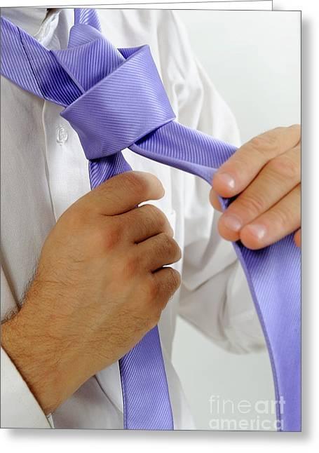 Man's Hands Adjusting Tie Greeting Card by Sami Sarkis