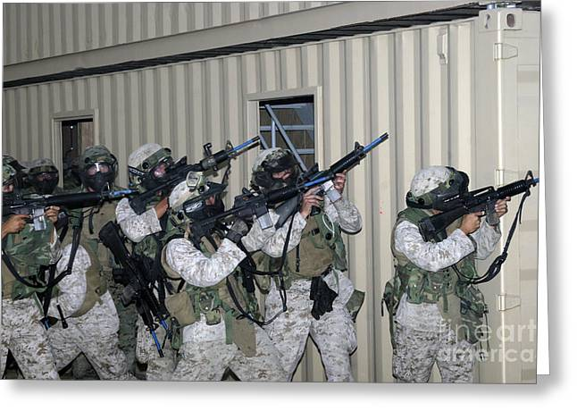 Marines Raise Their Weapons Greeting Card by Stocktrek Images
