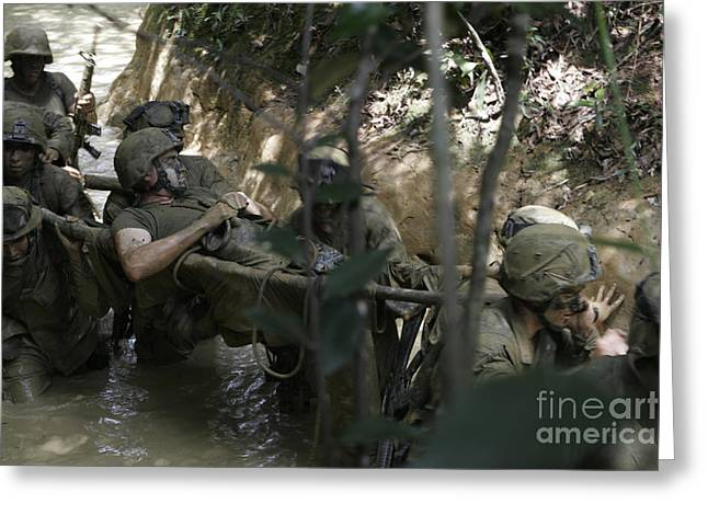 Marines Trudge Through The Mud Greeting Card by Stocktrek Images