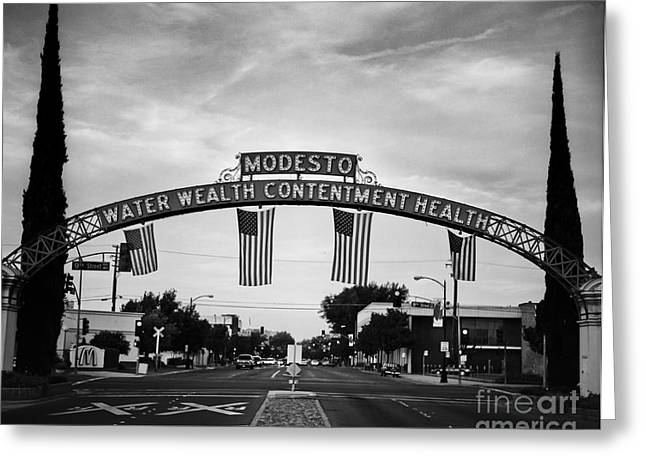 Modesto Arch With Flags Greeting Card by Jim and Emily Bush