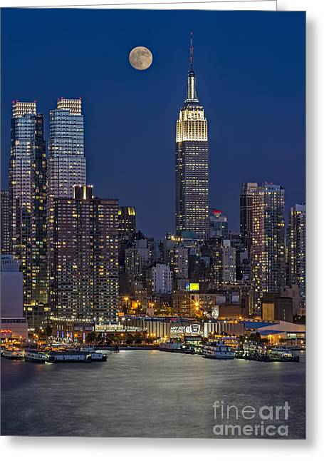 Moonrise Along The Empire State Building Greeting Card by Susan Candelario