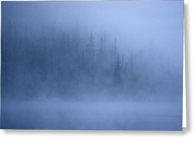 Morning Mist Rises Off A Lake Greeting Card by Kenneth Ginn