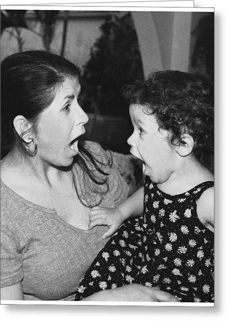 Mother And Child Greeting Card by Miguel Capelo