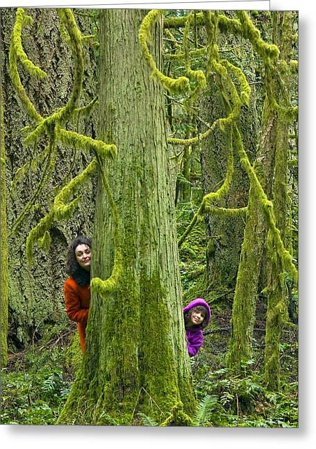 Mother And Daughter Playing In A Forest Greeting Card