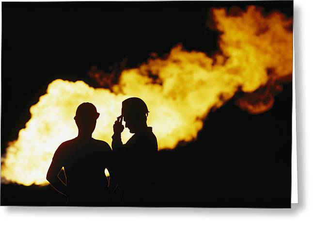 Natural Gas Workers Silhouetted Greeting Card by George F. Mobley