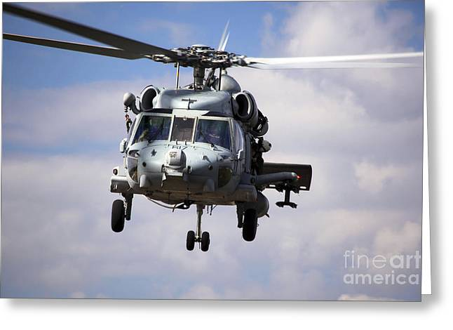 Navy Pilots In A Sh-60f Seahawk Conduct Greeting Card by Michael Wood