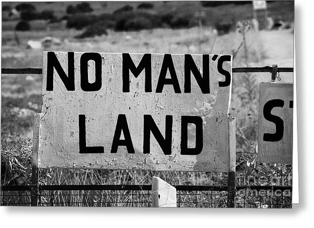no mans land and restricted area of the UN buffer zone in the green line dividing cyprus famagusta Greeting Card by Joe Fox