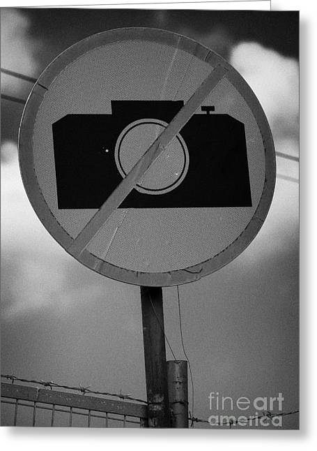 no photography sign at the greek cypriot army border post at the UN buffer zone cyprus green line Greeting Card by Joe Fox
