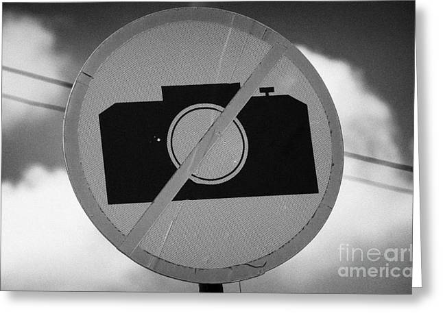 no photography sign at the greek cypriot army border post at the UN buffer zone green line cyprus Greeting Card by Joe Fox