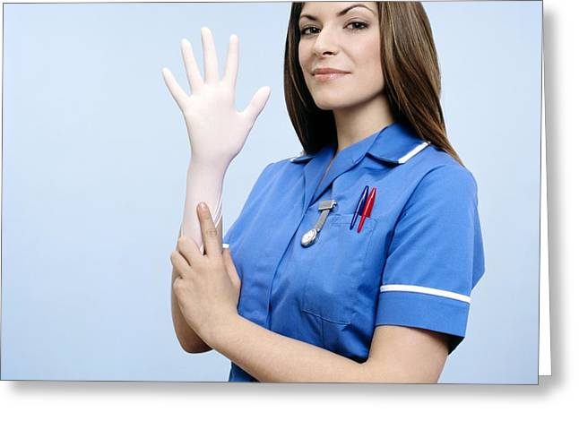 Nurse Pulling On A Glove Greeting Card by Kevin Curtis