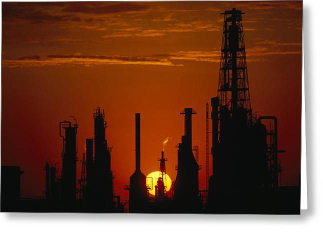 Oil Refinery Silhouetted Greeting Card by Paul Chesley