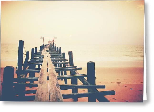 Old Wood Bridge To The Sea Greeting Card by Wanchai Yoosumran